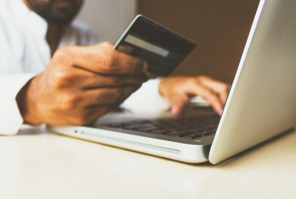 online shopping with credit card in hand